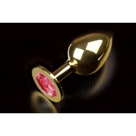 Большая золотая анальная пробка с закругленным кончиком и рубиновым кристаллом - 9 см.